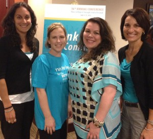 Brandi (in her run for her T-shirt) with conference attendees Michelle Osborn, Jennifer Rappo, and Gina Dayton